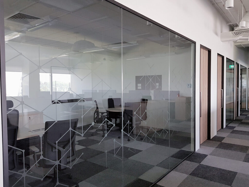 Glass Partition with Decorative Decal Manifestation